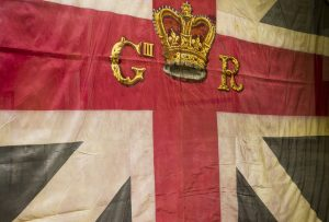Union Jack Flag bearing insignia and crown of George III