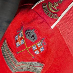 A Photograph featuring badges on the arm a military jacket