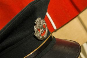 A military cap featuring the DCLI cap badge.