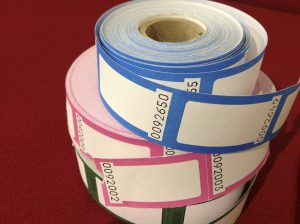Reels of coloured tickets
