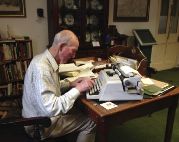 Regimental Historian Major Hugo White typing up research.