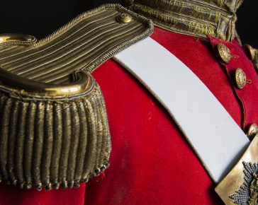 A uniform displaying the epaulette's and breast plate