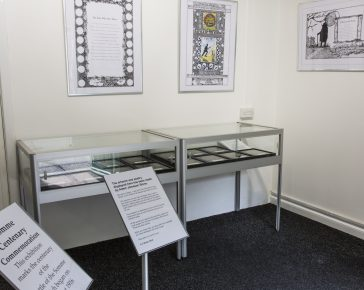 Two museum display cabinets and information stands