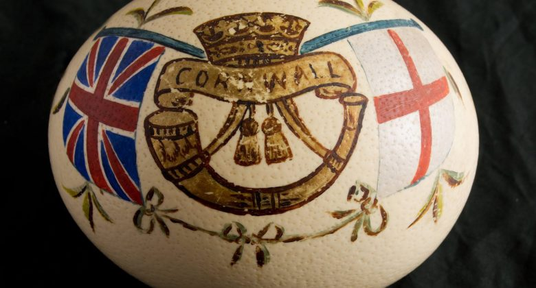 An Ostrich egg painted with the insignia of the Duke of Cornwall's Light Infantry