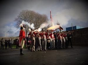 32nd of Foot reenactment group fire their muskets