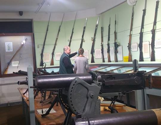 Displays of weaponry including rifles and bayonets in the museum's armoury