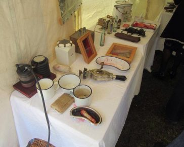 A display of medical kit laid out in an authentic WW1 field hospital