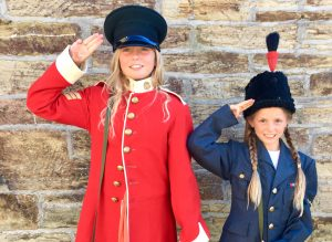 children dressing up in military uniforms