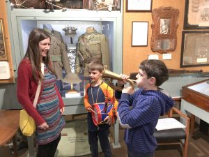 kids playing the instruments in Cornwalls Regimental Museum, Bodmin Keep