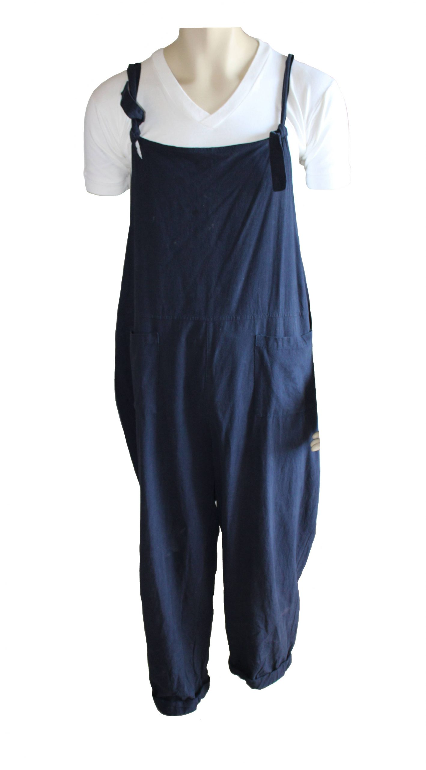 Dark blue dungarees over a white t-shirt