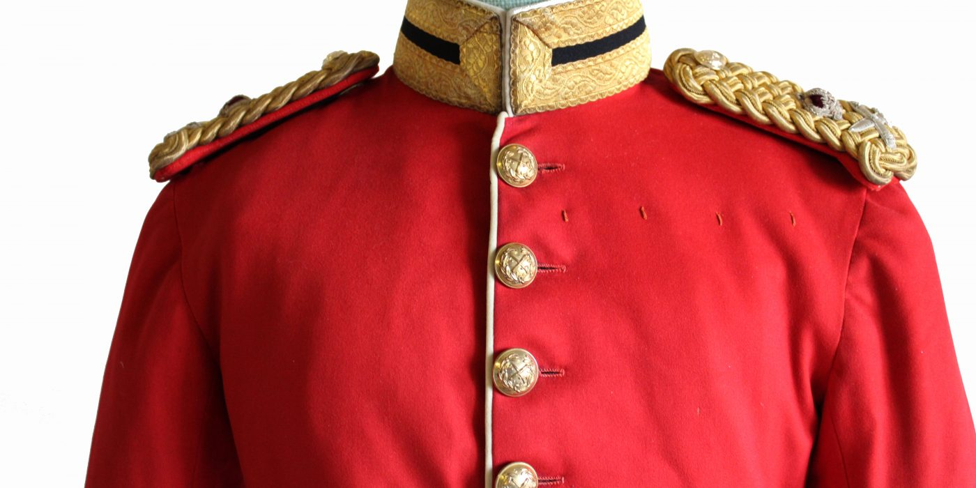 Red military jacket with gold buttons and shoulder epaulettes