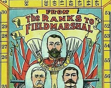 Picture of the centre of the board game showing the heads of three Field Marshals - King George V, Sir John French, Earl Kitchener.