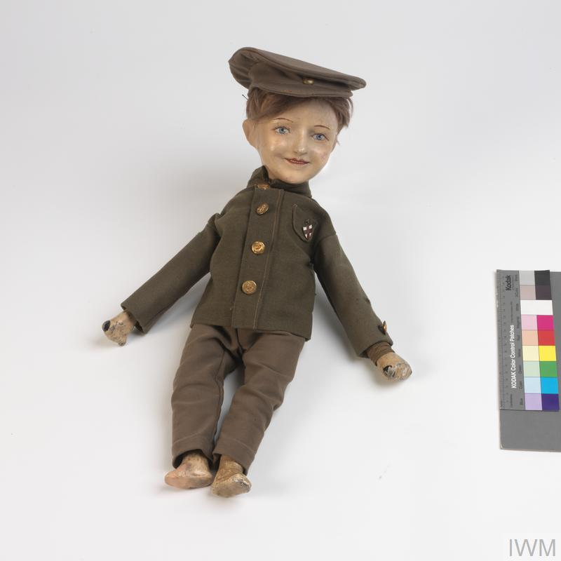 Wooden doll in a soldier's uniform from the First World War.