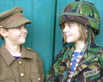 two Boys dressed in soldier uniform