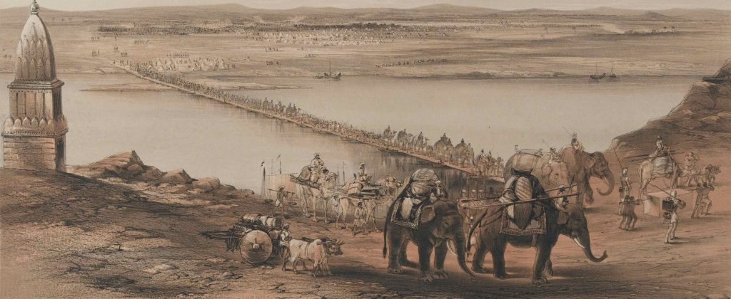 Series of wagons, carts, and elephants crossing a river on a bridge