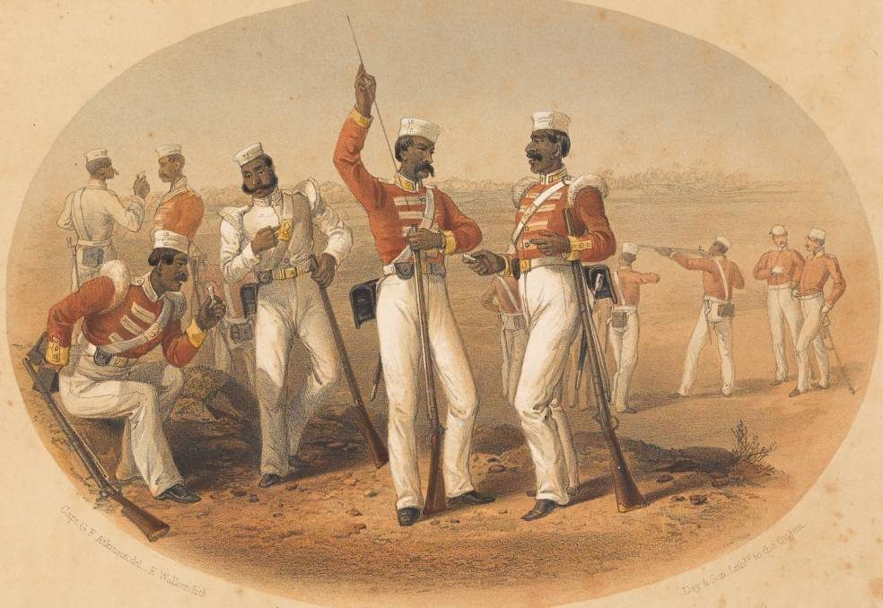 A group of Indian soldiers firing and loading rifles